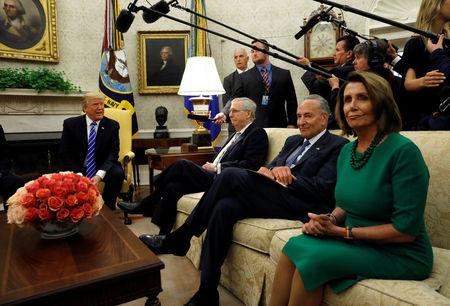 FILE PHOTO: U.S. President Donald Trump meets with Senate Majority Leader Mitch McConnell (L), U.S. Senate Democratic Leader Chuck Schumer (2nd R), House Minority Leader Nancy Pelosi (R) and other congressional leaders in the Oval Office of the White House in Washington, U.S., September 6, 2017.  REUTERS/Kevin Lamarque