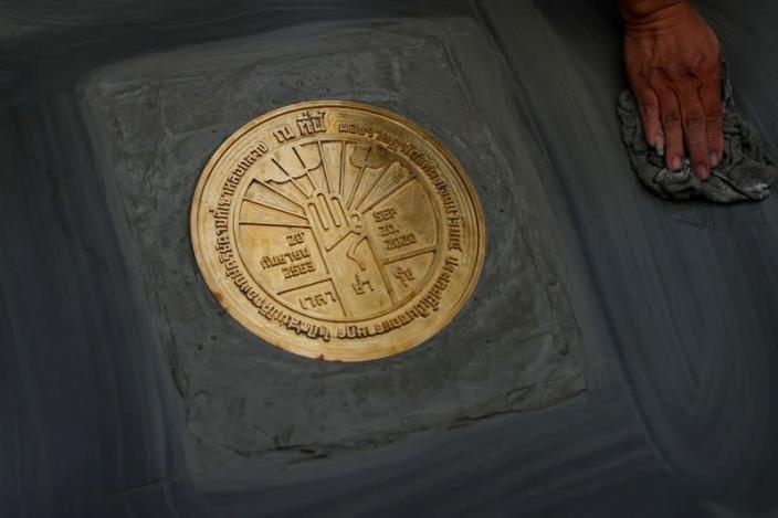 """A plaque declaring """"This country belongs to the people"""" is pictured during a mass rally to call for the ouster of Prime Minister Prayuth Chan-ocha and reforms in the monarchy, near the Grand Palace in Bangkok"""