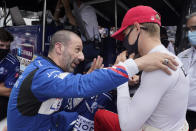 Tony Kanaan, left of Brazil, talks with Marcus Ericsson, of Sweden, during qualifications for the Indianapolis 500 auto race at Indianapolis Motor Speedway, Saturday, May 22, 2021, in Indianapolis. (AP Photo/Darron Cummings)