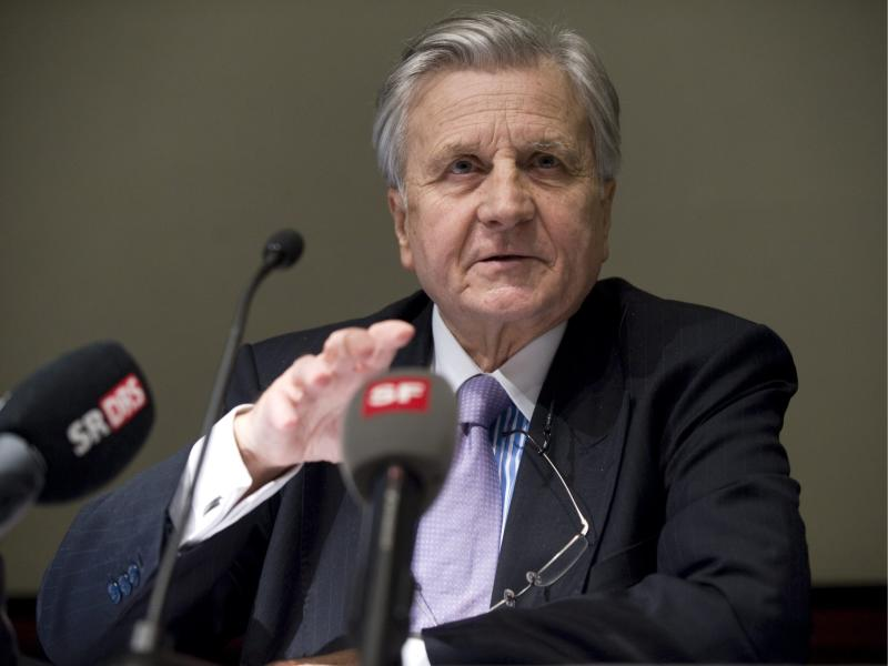"""Jean-Claude Trichet, president of the European Central Bank, speaks at a press conference on the occasion of the bimonthly meeting in the Hilton hotel in Basel, Switzerland, on Monday, Jan.  10, 2011. Central bank governors from the planet's biggest and most important economies agree the world is back on the road toward recovery after years of global financial turmoil.  European Central Bank President Jean-Claude Trichet says the recovery is """"confirmed in the eyes of"""" the group of central bank governors _ who found the buoyancy of emerging markets particularly impressive.  (AP Photo/Keystone/Georgios Kefalas)"""
