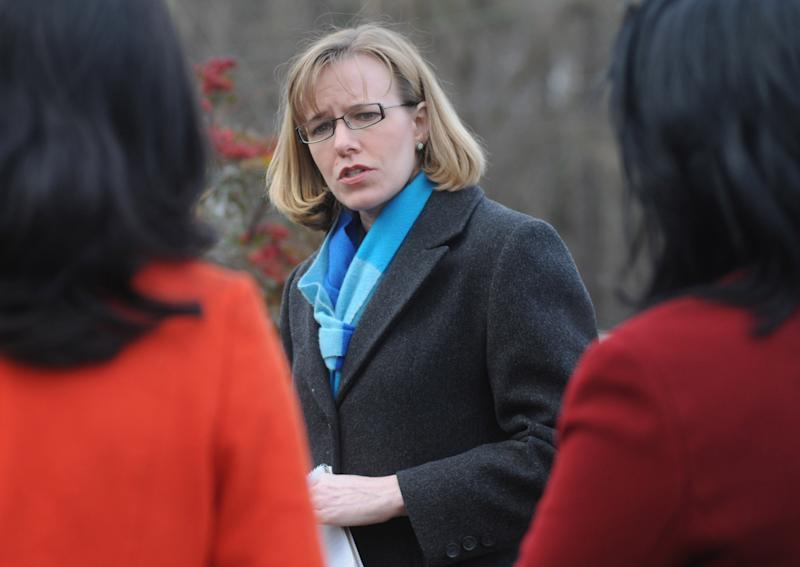 Corinne Geller, Virginia State Police spokeswoman, speaks after a trooper was shot and wounded following a traffic stop Thursday, March 7, 2013 in Dinwiddie County, Va. A suspect has been taken into custody. (AP Photo/The Progress-Index,Patrick Kane)