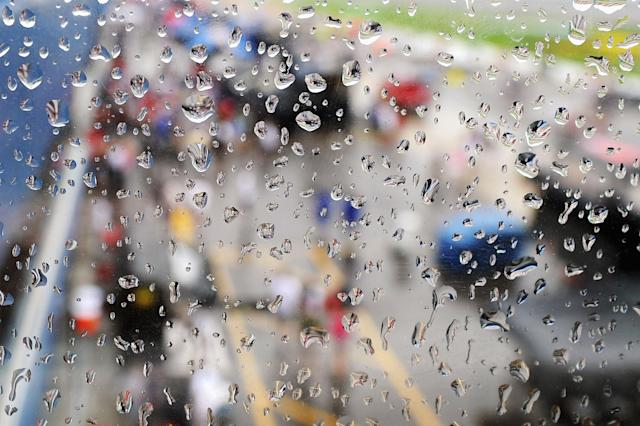 BROOKLYN, MI - JUNE 17: A general view of pit road through a window as rain falls before the NASCAR Sprint Cup Series Quicken Loans 400 at Michigan International Speedway on June 17, 2012 in Brooklyn, Michigan. (Photo by Drew Hallowell/Getty Images for NASCAR)