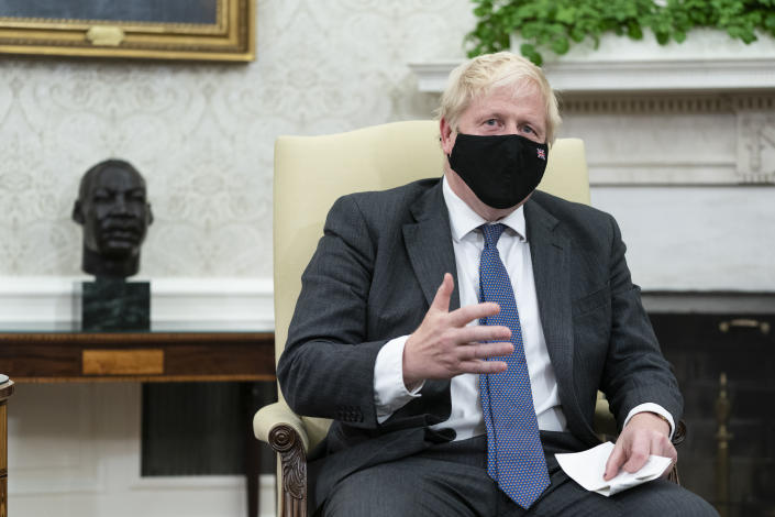 British Prime Minister Boris Johnson speaks during a meeting with President Joe Biden in the Oval Office of the White House, Tuesday, Sept. 21, 2021, in Washington. (AP Photo/Alex Brandon)
