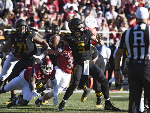 Missouri quarterback Drew Lock leads the nation in touchdown passes. (AP Photo/Michael Woods)