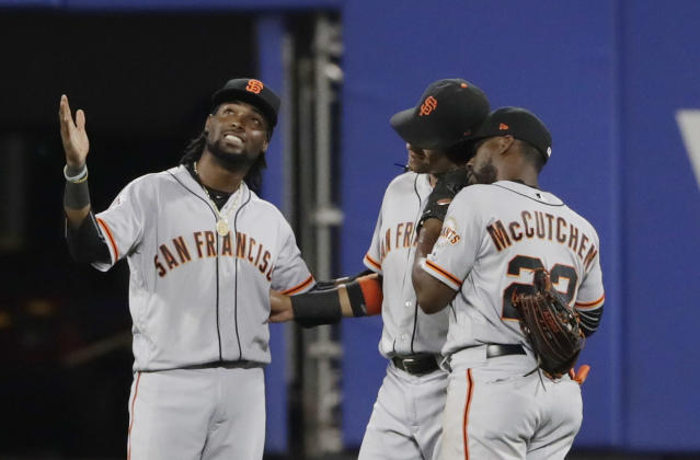 San Francisco Giants' Alen Hanson, left, celebrates with teammates Gorkys Hernandez and Andrew McCutchen, right, after a baseball game against the New York Mets Monday, Aug. 20, 2018, in New York. The Giants won 2-1.(AP Photo/Frank Franklin II)