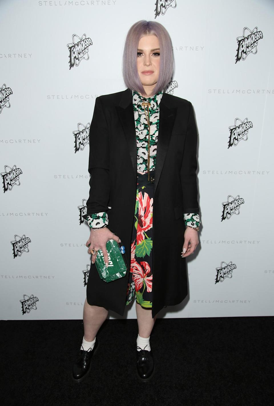 <p>Kelly Osbourne looked as fantastically quirky as ever in a floral ensemble teamed with a black coat.<i> [Photo: Rex]</i></p>