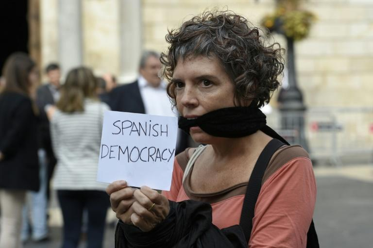 A protester in Barcelona demands freedom for detained Catalan separatist leaders