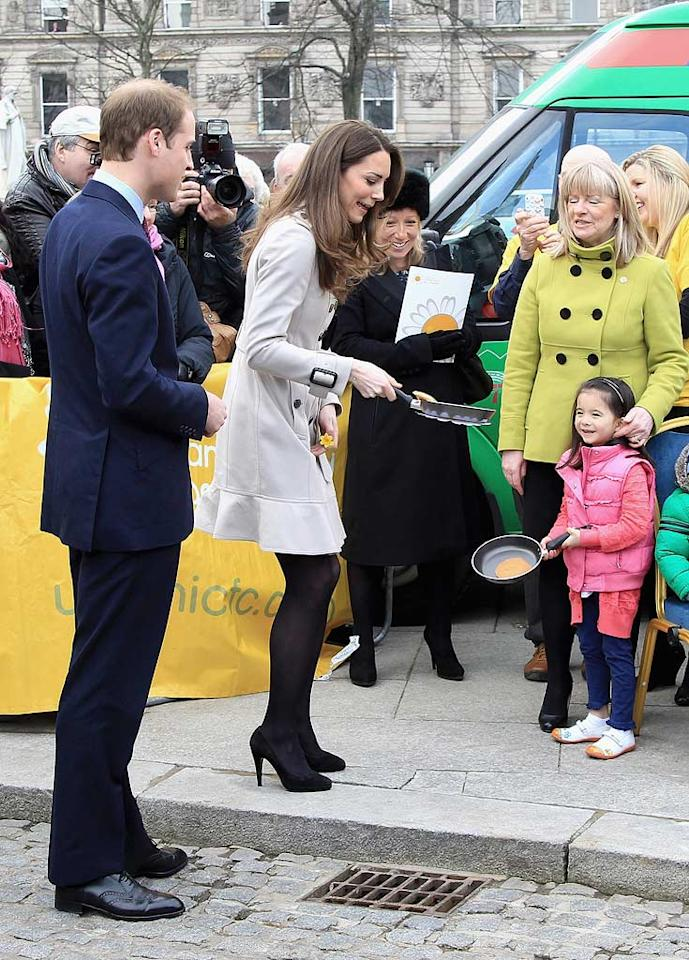 """Kate Middleton showed off one of her many skills -- pancake flipping! -- during a visit to Belfast, Northern Ireland, on Shrove Tuesday. It was the soon-to-be princess and her fiance Prince William's first official visit to Northern Ireland before their April 29 wedding. When one onlooker shouted to Kate that she was a very lucky lady, Kate replied, """"I am lucky. He's a very nice man and I'm looking forward to spending the rest of my life with him."""" Chris Jackson/<a href=""""http://www.gettyimages.com/"""" target=""""new"""">GettyImages.com</a> - March 8, 2011"""