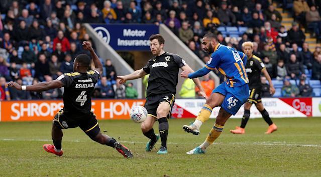 "Soccer Football - League One - Shrewsbury Town vs AFC Wimbledon - Montgomery Waters Meadow, Shrewsbury, Britain - March 24, 2018 Shrewsbury Town's Stefan Payne shoots at goal Action Images/Ed Sykes EDITORIAL USE ONLY. No use with unauthorized audio, video, data, fixture lists, club/league logos or ""live"" services. Online in-match use limited to 75 images, no video emulation. No use in betting, games or single club/league/player publications. Please contact your account representative for further details."