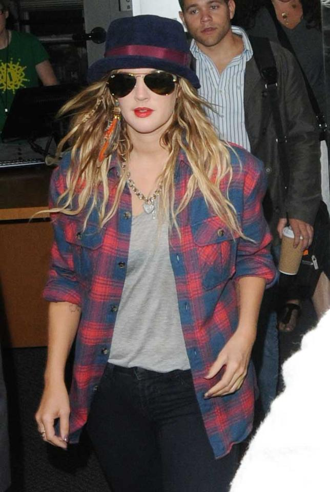 "Screen queen Drew Barrymore showed her love for plaid flannel in London. <a href=""http://www.splashnewsonline.com"" target=""new"">Splash News</a> - August 20, 2010"