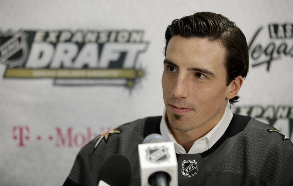 FILE - Vegas Golden Knights' Marc-Andre Fleury speaks with the media in Las Vegas, in this Wednesday, June 21, 2017, file photo. This was an unprecedented offseason of goaltender movement around the NHL. Vegas traded Vezina Trophy winner Marc-Andre Fleury to Chicago. Fleury was the face of the Golden Knights franchise, and received assurances from Vegas owner Bill Foley that he'd retire there. (AP Photo/John Locher, File)