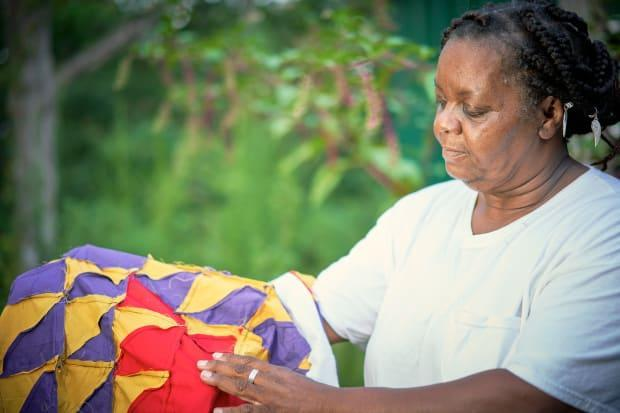 Mary Margaret Pettway showing a quilt in process.