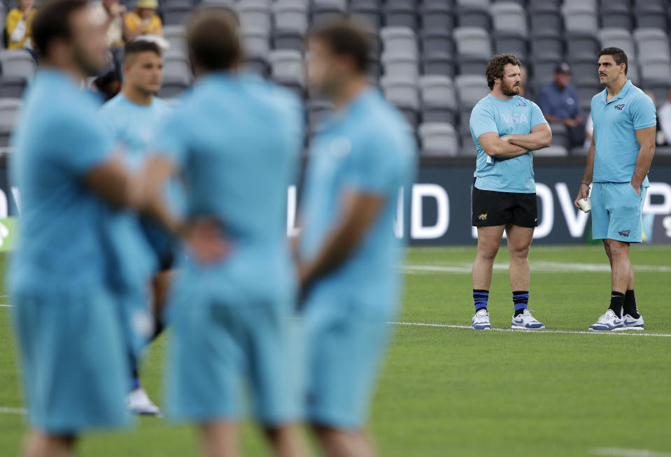Argentina's Pablo Matera, right, and Julian Montoya talk on the field prior to their Tri-Nations rugby union match against Australia in Sydney, Australia, Saturday, Dec. 5, 2020. (AP Photo/Rick Rycroft)
