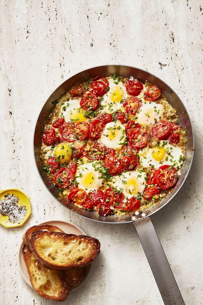 """<p>This easy and hearty breakfast dish is a one-skillet meal that only takes 35 minutes to make.</p><p><a href=""""https://www.goodhousekeeping.com/food-recipes/a34908201/easy-shakshuka-recipe/"""" rel=""""nofollow noopener"""" target=""""_blank"""" data-ylk=""""slk:Get the Shakshuka recipe."""" class=""""link rapid-noclick-resp""""><em>Get the Shakshuka recipe.</em></a></p>"""