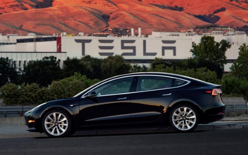 FILE PHOTO: First production model of Tesla Model 3 out the assembly line is seen in this undated handout photo from Tesla Motors
