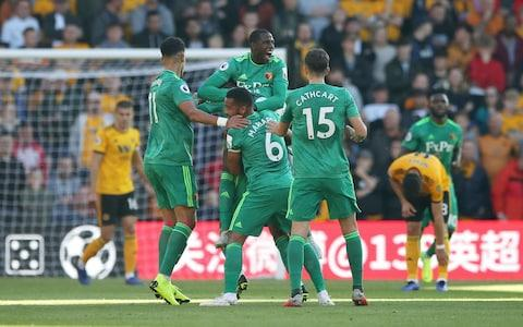 Watford's Etienne Capoue (obscured) celebrates scoring his side's first goal of the game against Wolves with team mates Adam Masina (left), Abdoulaye Doucoure (back), Adrian Mariappa and Craig Cathcart - Credit: Nick Potts/PA Wire