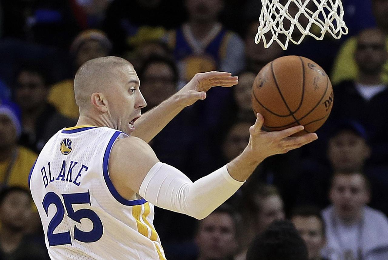 Golden State Warriors' Steve Blake passes during the first half of an NBA basketball game against the Houston Rockets Thursday, Feb. 20, 2014, in Oakland, Calif. (AP Photo/Ben Margot)