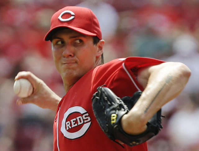 Cincinnati Reds starting pitcher Homer Bailey throws against the Pittsburgh Pirates in the first inning of a baseball game, Thursday, June 20, 2013, in Cincinnati. (AP Photo/Al Behrman)