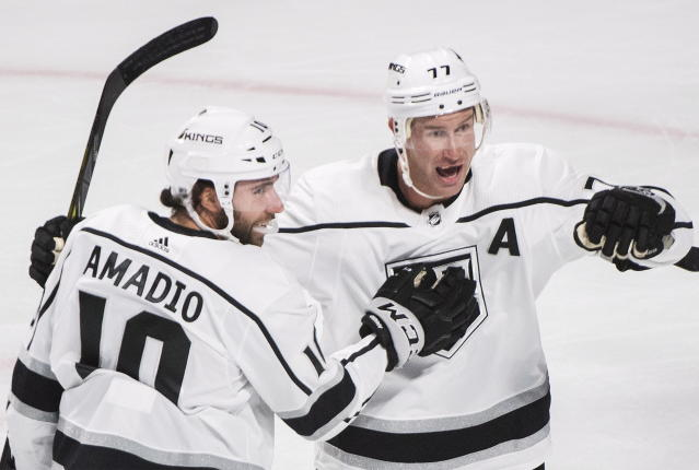 Los Angeles Kings' Michael Amadio, left, celebrates with Jeff Carter (77) after scoring against the Montreal Canadiens during the first period of an NHL hockey game Thursday, Oct. 11, 2018, in Montreal. (Graham Hughes/The Canadian Press via AP)