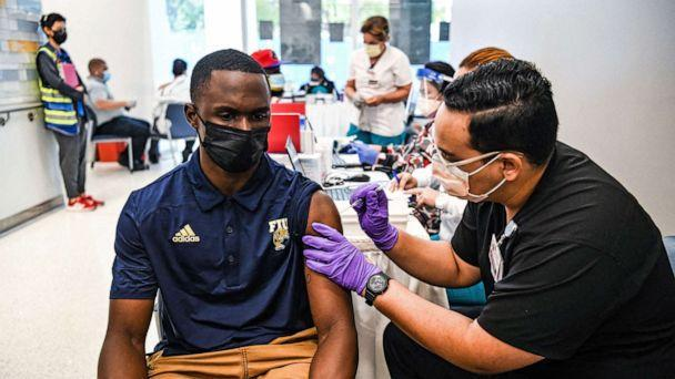 PHOTO: Pharmacy student Jason Rodriguez administers a COVID-19 vaccine to Larry Grier at the Christine E. Lynn Rehabilitation Center in Miami, April 15, 2021. (Chandan Khanna/AFP via Getty Images)
