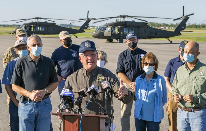 Louisiana Gov. John Bel Edwards talks about the devastation from Hurricane Delta after flying over the stricken areas in southwest Louisiana during a press conference at the airport Saturday Oct. 10, 2020, in Jennings, La. (Bill Feig/The Advocate via AP, Pool)