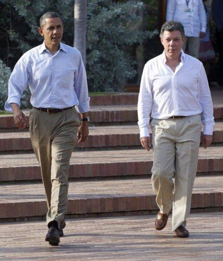 US President Barack Obama (L) and Colombian President Juan Manuel Santos arrive for a joint press conference in the framework of the VI Summit of the Americas at Casa de Huespedes in Cartagena, Colombia. Obama joined Santos and pop superstar Shakira at a ceremony to hand over land titles to descendants of Colombia's runaway African slaves