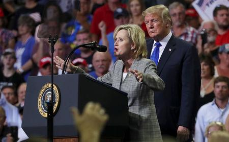 FILE PHOTO: U.S. Senator Cindy Hyde-Smith (R-MS) joins President Donald Trump onstage at a campaign rally in Southaven, Mississippi, U.S. October 2, 2018.  REUTERS/Jonathan Ernst/File Photo