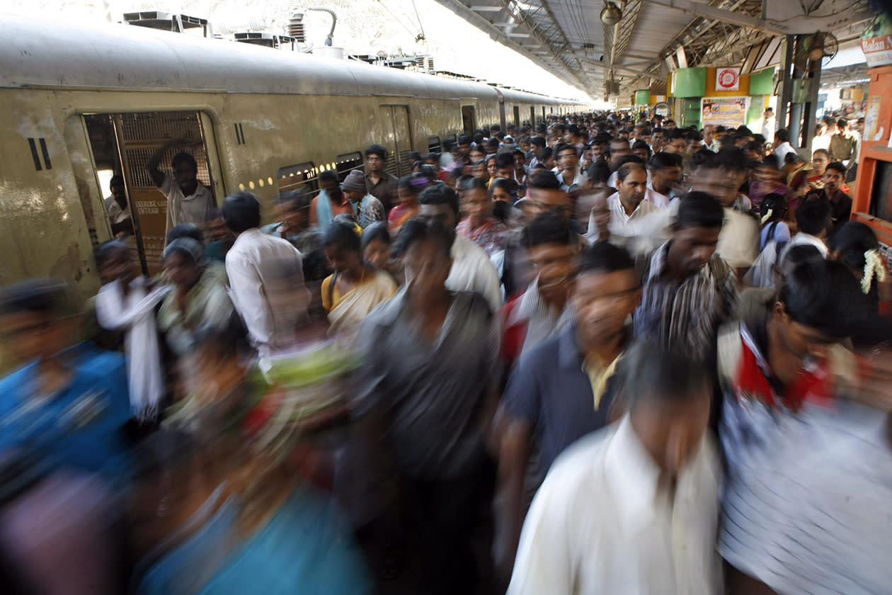 Indian commuters crowd a railway platform in Chennai, India.