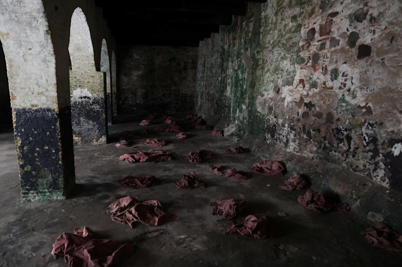 Clothes left behind by performers reenacting what female slaves went through during their detention at the Elmina Castle, lie on the floor at the castle in Ghana. (Photo: Siphiwe Sibeko/Reuters)
