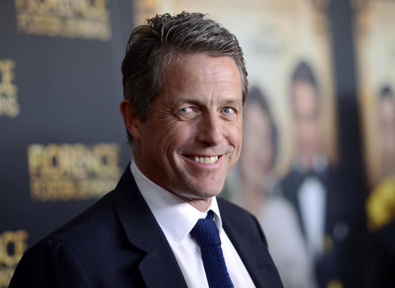 """FILE - This Aug. 9, 2016 file photo shows actor Hugh Grant at the premiere of """"Florence Foster Jenkins"""" in New York. Grant will be among several cast members from the 2003 film, """"Love Actually,"""" returning for a 10-minute reunion film airing as part of Comic Relief's """"Red Nose Day Special"""" on NBC in May. (Photo by Evan Agostini/Invision/AP, File)"""