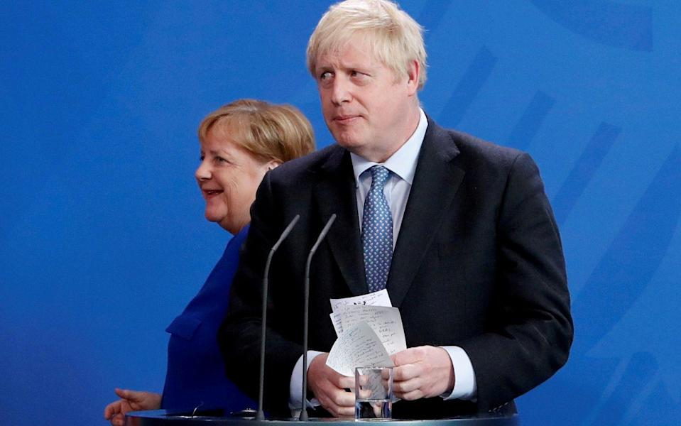 Boris Johnson (right) and Angela Merkel - REUTERS