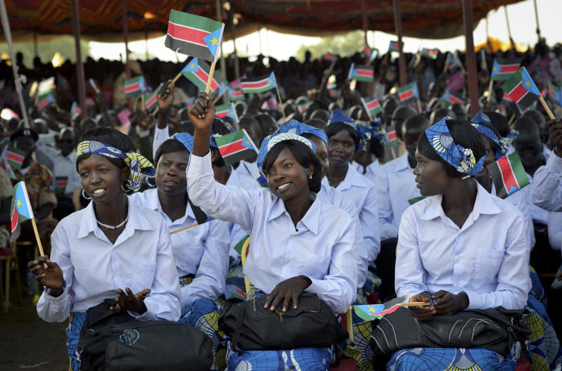 Women wave South Sudanese flags as they attend the country's anniversary celebrations, at the John Garang mausoleum in Juba, South Sudan, Monday, July 9, 2012. The world's newest nation, South Sudan, is celebrating its first birthday and while the largest achievement over the last year was avoiding a return to all-out war with Sudan, the south has seen its economy crippled after it shut down its oil industry and thousands of refugees are streaming into the country every week to avoid violence on Sudan's side of the border. (AP Photo/Shannon Jensen)