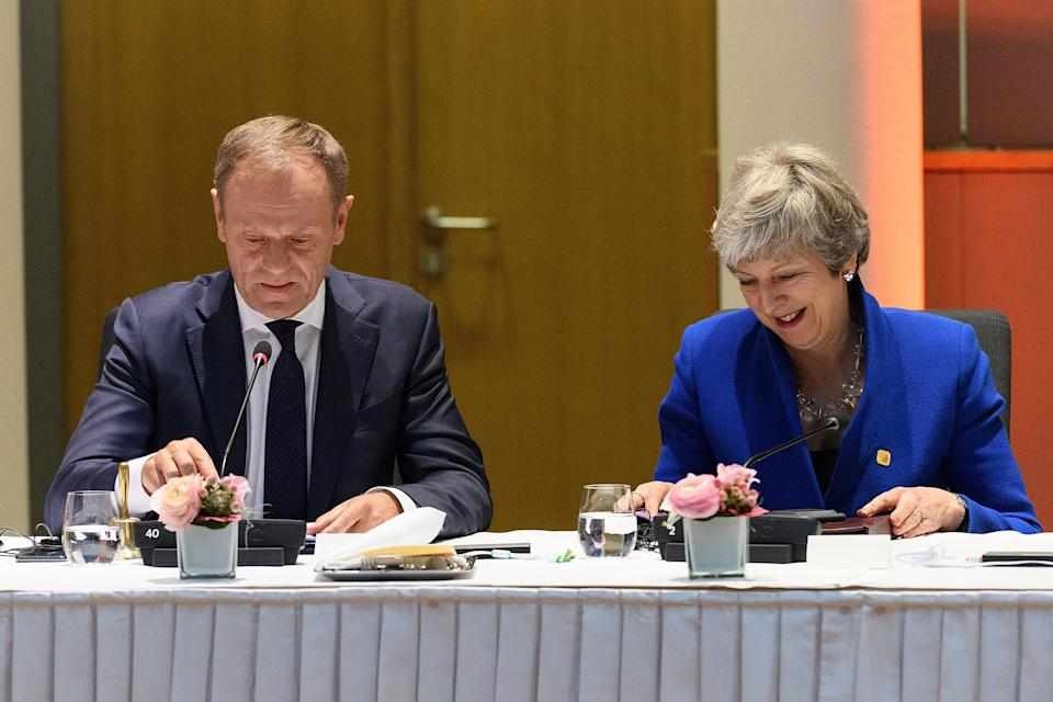 Donald Tusk and Theresa May attend a round table meeting in Brussels last week (Picture: PA)