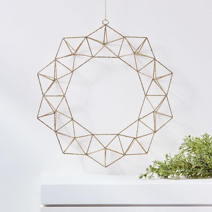 "<p>westelm.com</p><p><strong>$18.00</strong></p><p><a href=""https://go.redirectingat.com?id=74968X1596630&url=https%3A%2F%2Fwww.westelm.com%2Fproducts%2Fglitter-geo-wreath-d5539&sref=https%3A%2F%2Fwww.elledecor.com%2Fdesign-decorate%2Fg2825%2Fbest-christmas-wreaths%2F"" rel=""nofollow noopener"" target=""_blank"" data-ylk=""slk:Shop Now"" class=""link rapid-noclick-resp"">Shop Now</a></p><p>This geometric wreath is a modern take on a tradition, with endless allure. </p>"