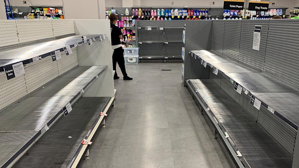 Empty Woolworths shelves