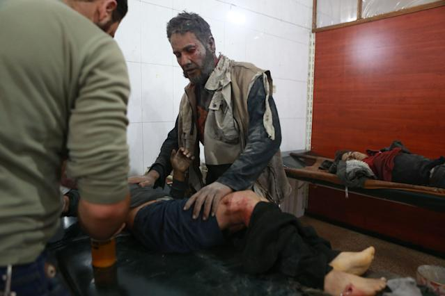A Syrian man looks after his son, who is receiving treatment at a hospital after he was injured and his sister was killed in a reported airstrike in the rebel-controlled town of Hamouria, in the eastern Ghouta region on the outskirts of the capital Damascus, on Dec. 3, 2017. (Photo: Abudlmonam Eassa/AFP/Getty Images)