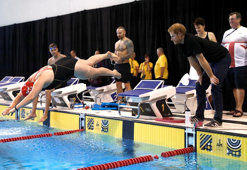 Prince Harry watches swimmers preparing for the Invictus Games.