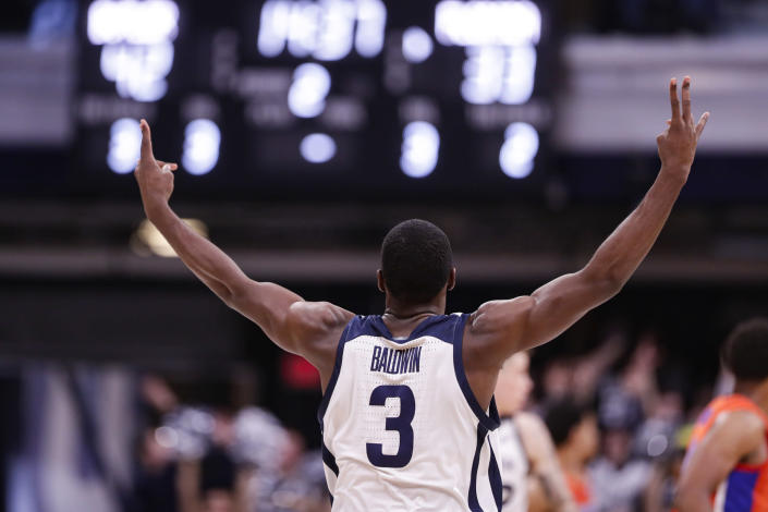 Butler guard Kamar Baldwin (3) celebrates a 3-point basket against Florida in the second half of an NCAA college basketball game in Indianapolis, Saturday, Dec. 7, 2019. Butler defeated Florida 76-62. (AP Photo/Michael Conroy)