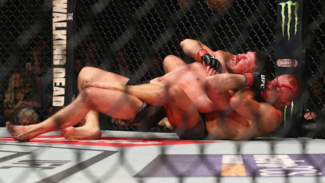 A rear-naked choke saw Georges St-Pierre beat Michael Bisping to win the UFC middleweight championship.
