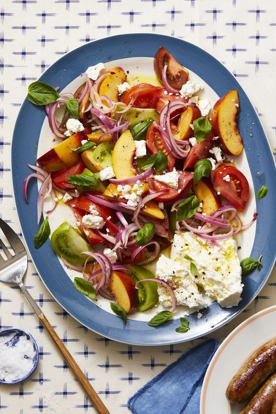 """<p>This 10-minute, sweet and savory salad adds a twist to juicy in-season peaches.</p><p><em><a href=""""https://www.goodhousekeeping.com/food-recipes/a28136659/tomato-peach-and-basil-salad-recipe/"""" rel=""""nofollow noopener"""" target=""""_blank"""" data-ylk=""""slk:Get the recipe for Tomato, Peach, and Basil Salad »"""" class=""""link rapid-noclick-resp"""">Get the recipe for Tomato, Peach, and Basil Salad » </a></em></p><p><strong>RELATED: </strong><a href=""""https://www.goodhousekeeping.com/food-recipes/healthy/g180/healthy-salads/"""" rel=""""nofollow noopener"""" target=""""_blank"""" data-ylk=""""slk:31 Healthy Salads for a Very Filling, Very Un-boring Meal"""" class=""""link rapid-noclick-resp"""">31 Healthy Salads for a Very Filling, Very Un-boring Meal</a><br></p>"""