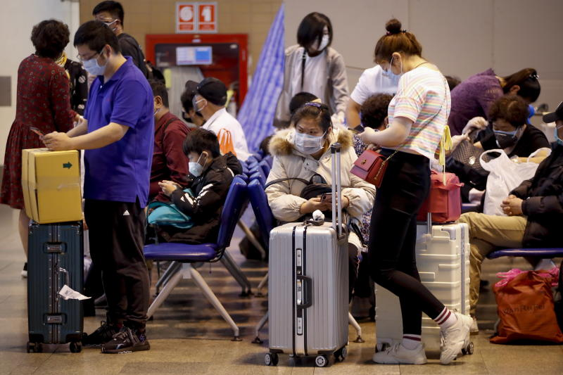 Chinese tourists wearing protective masks wait for their flight at Don Mueang airport in Bangkok, Thailand.