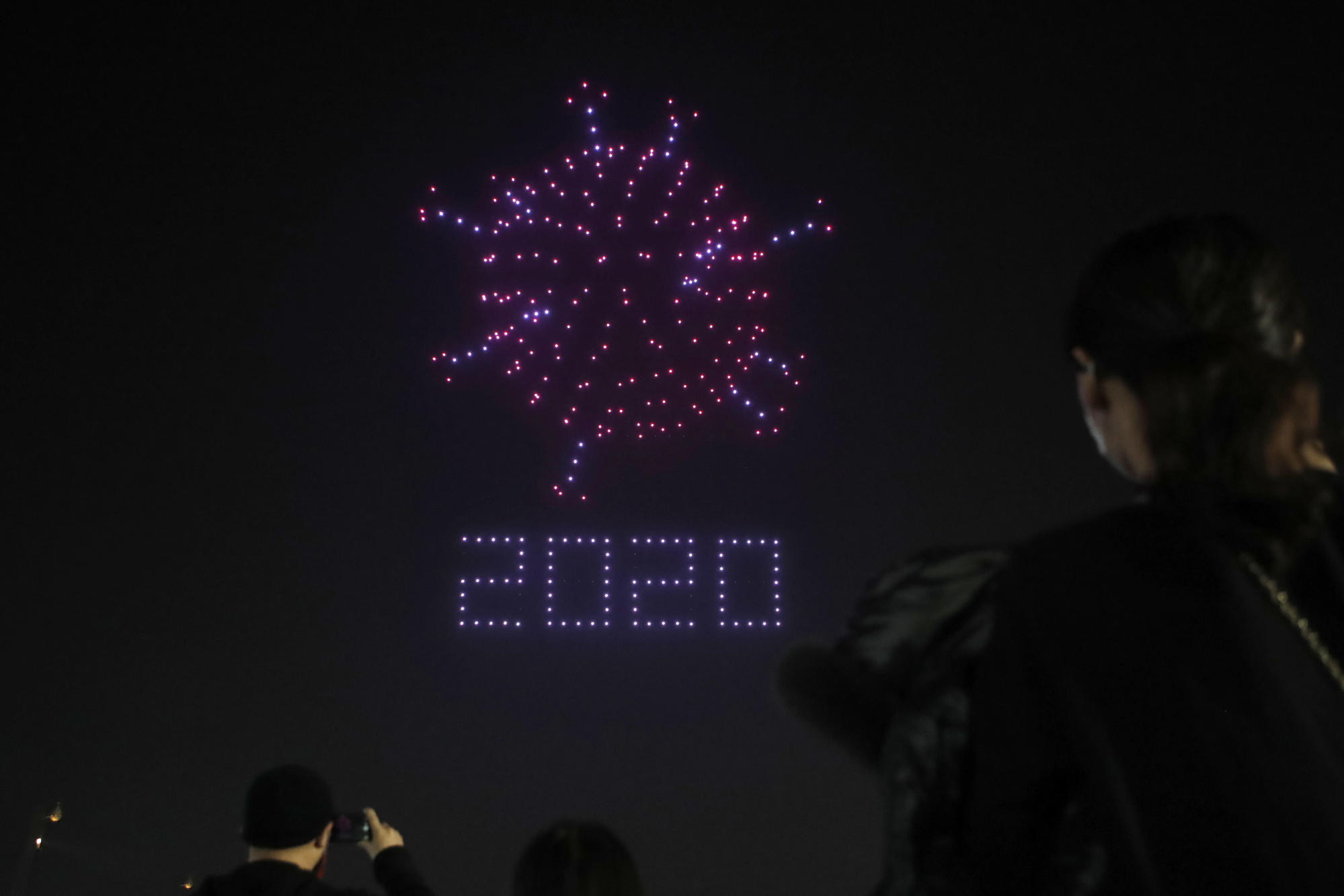 AP PHOTOS: Drones light up Seoul sky, urge virus vigilance