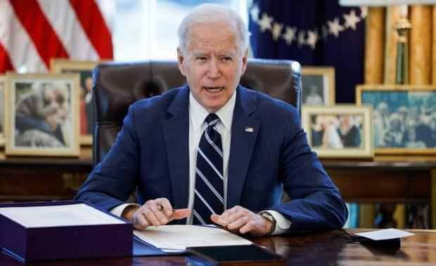 U.S. President Joe Biden signed his first major law Thursday, a sprawling stimulus bill that will have economic and social consequences, after it passed both chambers of Congress. (Tom Brenner/Reuters - image credit)