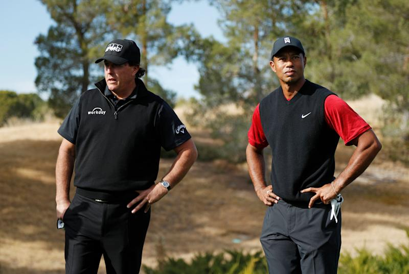 Phil Mickelson, left, and Tiger Woods stand at the first tee before a golf match at Shadow Creek golf course, Friday, Nov. 23, 2018, in Las Vegas. (AP Photo/John Locher)
