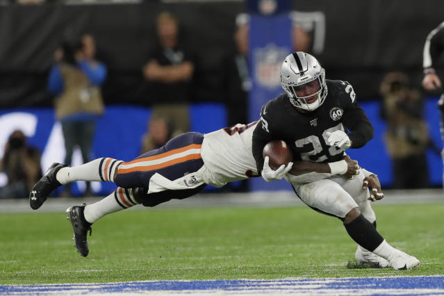 Oakland Raiders running back Josh Jacobs (28) is tackled during the second half of an NFL football game against the Chicago Bears at Tottenham Hotspur Stadium, Sunday, Oct. 6, 2019, in London. (AP Photo/Kirsty Wigglesworth)
