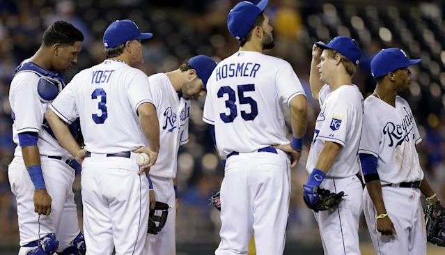 Kansas City Royals manager Ned Yost (3) meets with his players on the mound during a pitching change in the eighth inning of a baseball game against the Chicago White Sox, Wednesday, Aug. 21, 2013, in Kansas City, Mo. (AP Photo/Charlie Riedel)