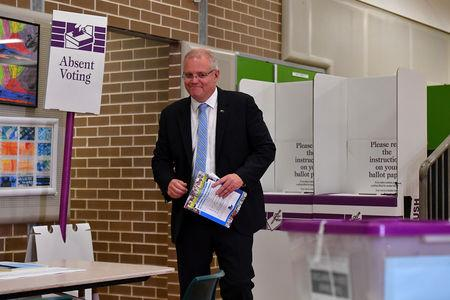 FILE PHOTO: Australian Prime Minister Scott Morrison casts his vote on Election day, at Lilli Pilli Public School, in Sydney, Saturday, 18 May, 2019. AAP Image/Mick Tsikas/via REUTERS