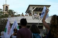 United Nations peacekeepers watched the rallies on Saturday; Cyprus has been divided since 1974