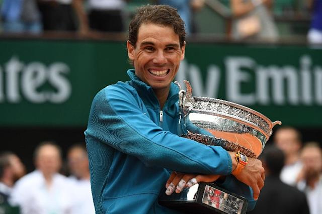 French Open champion Rafael Nadal will miss the Wimbledon warm-up at Queen's Club (AFP Photo/Christophe ARCHAMBAULT)