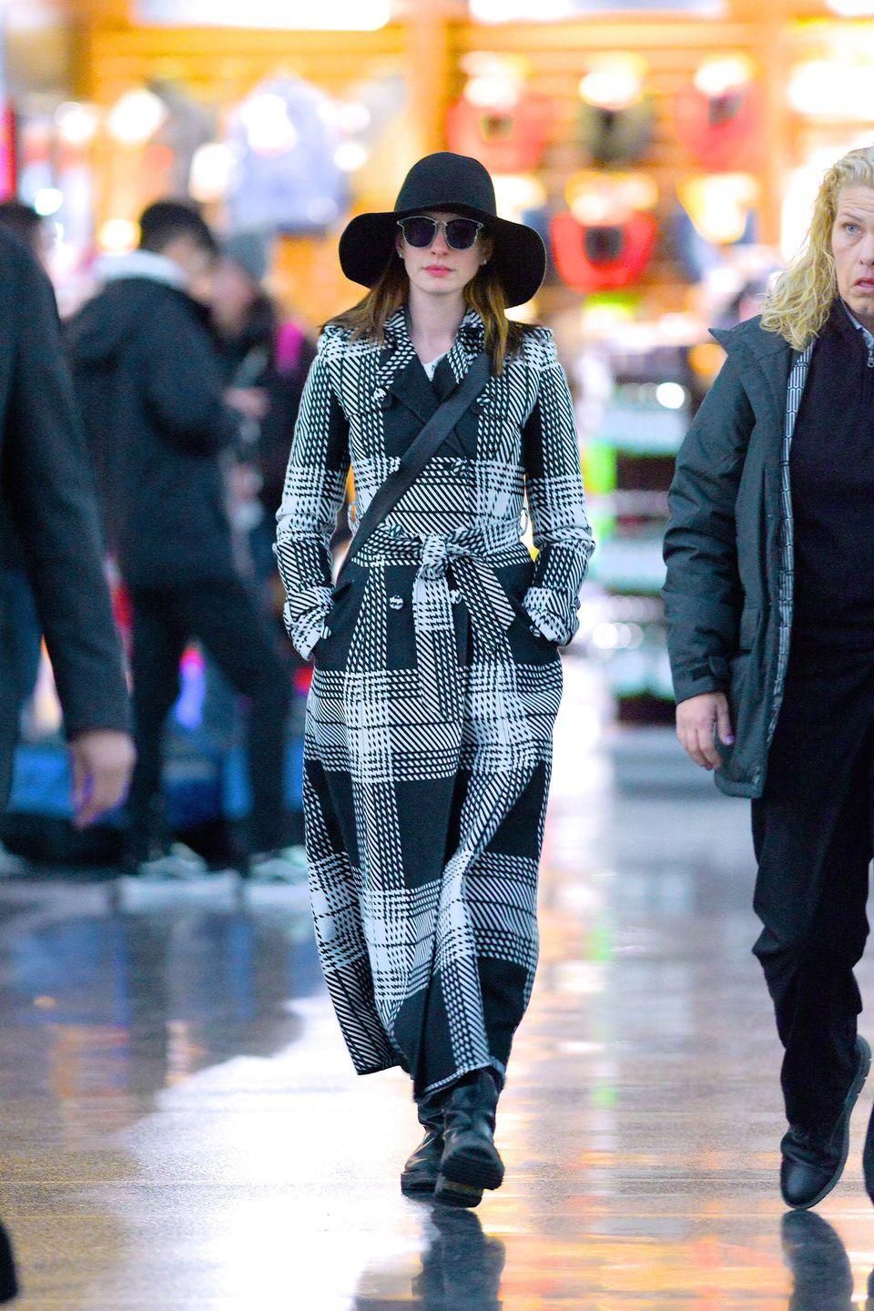 """<p><strong>Anne Hathaway, 2019:</strong> Sunglasses can be great disguises and help stars avoid making eye contact in public, but pair it with a chic coat and a hat, this ensemble becomes more of a """"look at me"""" put-together outfit. There's no hiding here!</p>"""